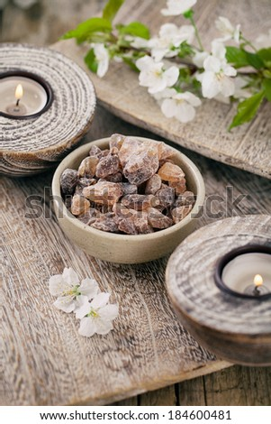 Spa and wellness setting with natural soap, candles and towel. Beige dayspa nature set. Bath salt - stock photo