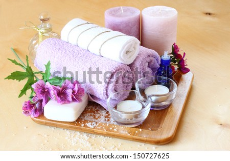 Spa and wellness setting with natural soap, candles and towel. natural wooden background   - stock photo