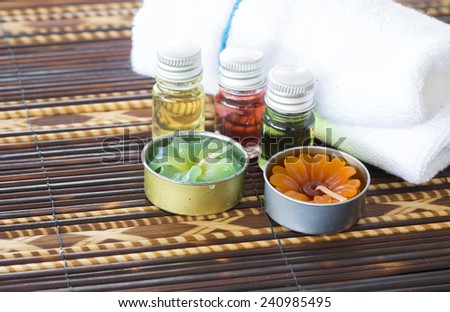 Spa and wellness setting with natural soap, candles and towel. spa nature set - stock photo