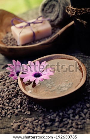 Spa and wellness setting with natural soap, candles and towel. Violet dayspa nature set dayspa nature set - stock photo