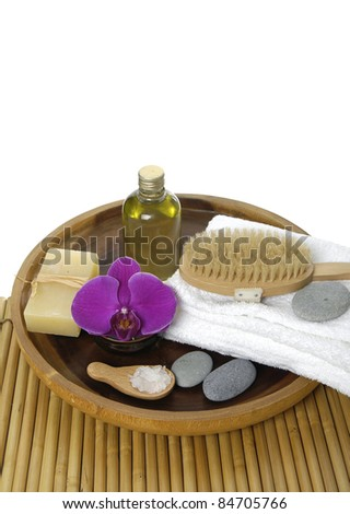 Spa and wellness: towel, massage oil, orchid, soap, brush, stones - stock photo