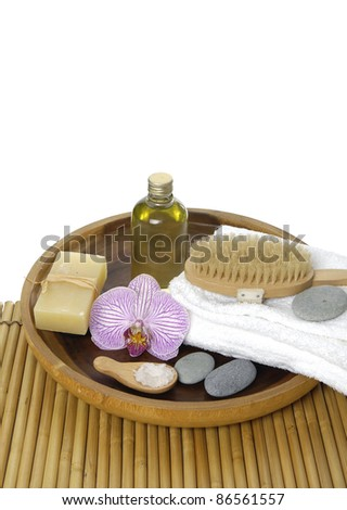 Spa and wellness( towel, massage oil, orchid, soap, brush, stones) - stock photo