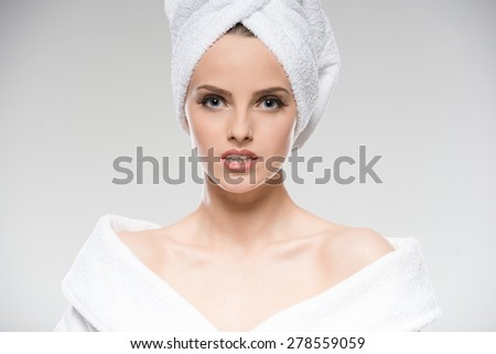 Spa and Wellness. Young beautiful woman in bathrobe and towel in spa salon. - stock photo