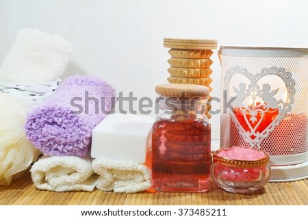 SPA - Aromatic sea salt and scented soap, scented candles and massage oil and accessories for massage and bath