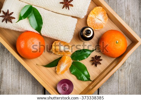 Spa assortment with organic tangerine essential oil - stock photo