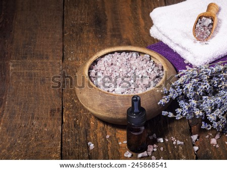 Spa background with bunch of lavender and purple sea salt. Copy space. - stock photo