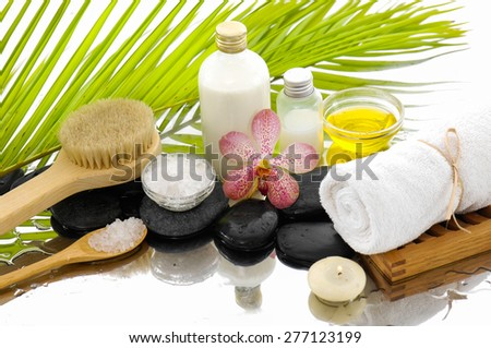 Spa Background with green palm,towel,oil,stones - stock photo