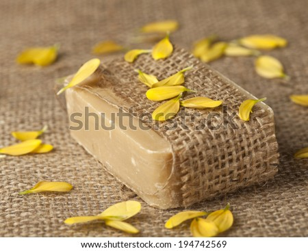 Spa background with homemade soap and yellow leaves. - stock photo