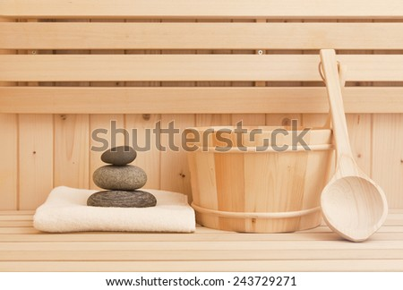 spa background with zen stones and sauna accessories - stock photo