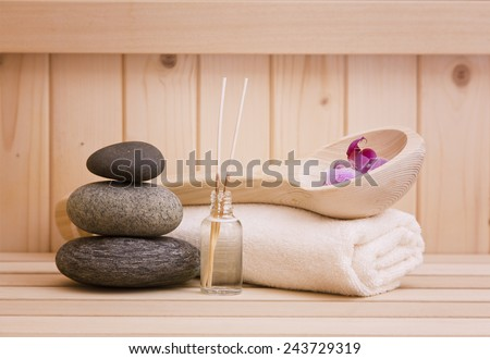 spa background with zen stones and sauna accessories