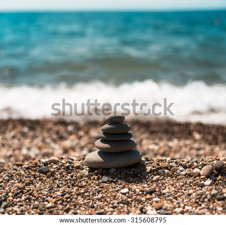 Spa balance stones, over blue calm sea background, conceptual image of relaxation - stock photo