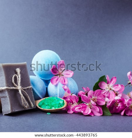 Spa bath cosmetic and flower branch. Soap beauty treatment background. Aromatherapy with natural salt and bath bomb. Hygiene and relaxation for body. Luxury therapy and care.  - stock photo