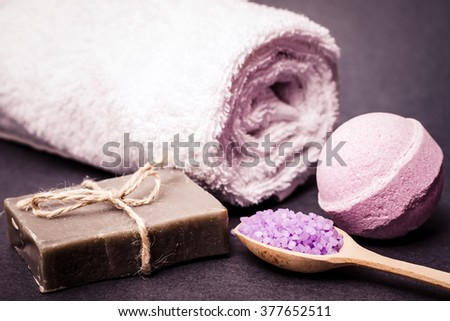 Spa bath cosmetic. Soap beauty treatment background. Aromatherapy with natural salt and bath bomb. Hygiene and relaxation for body. White towel. Luxury therapy and care.  - stock photo