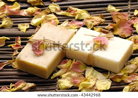 Spa bath setting- soap ,rose withered petals - stock photo