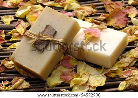 Spa bath setting-towel and soap ,rose petals - stock photo