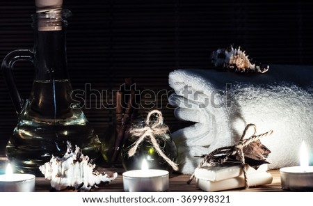 spa, beautiful seashells, oil, cinnamon, handmade soap - stock photo