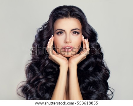Spa Beauty and Skincare Concept. Spa Woman Fashion Model with Healthy Hair and Skin. Brunette with Natural Makeup, Long Curly Hairstyle and Manicure