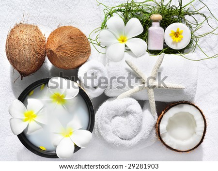 spa beauty exotic tropical flowers sea shells  towels salt soap - stock photo