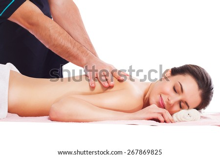 Spa beauty skin treatment woman on white towel. Caucasian female model with perfect skin lying on towel. Young woman isolated on white background. - stock photo