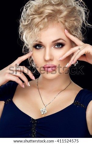 Spa, beauty, skincare, wellness and health. Glamour close-up portrait of beautiful woman model face with purity healthy skin and gold make-up and french manicure.  - stock photo