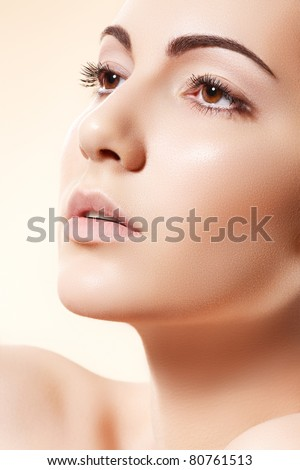 Spa, beauty, skincare, wellness & health. Glamour close-up portrait of beautiful woman model face with purity healthy skin & light make-up on bright beige background