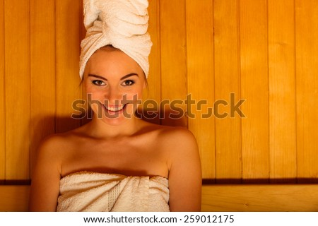 Spa beauty treatment and lifestyle relaxation concept. woman white towel relaxing in wooden sauna room. - stock photo