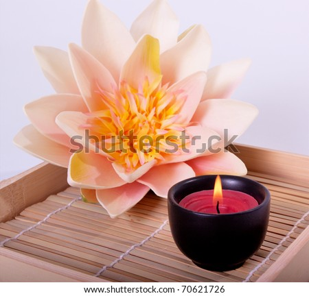 Spa candle and beautiful lotus flower for aromatherapy meditation - stock photo