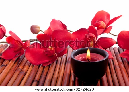 Spa candle and colorful flower for aromatherapy meditation - stock photo