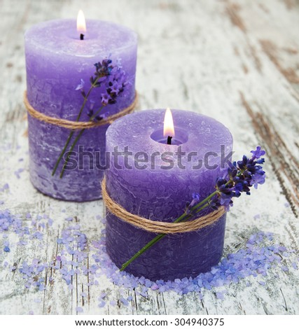 Spa candles  and lavender flowers on a wooden background - stock photo