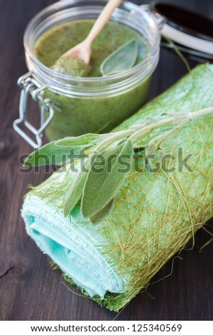 Spa care and treatment: body scrub with herbs - stock photo