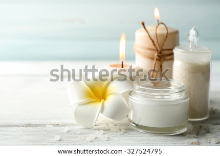 Spa coconut products on light wooden background - stock photo