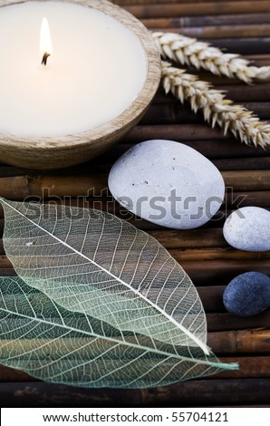 SPA composition - candle, leaves and stones - stock photo