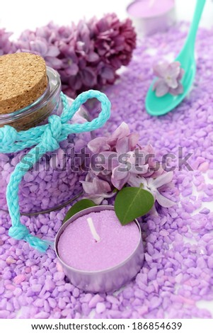 spa composition of candle, bottle and lilac flowers - stock photo
