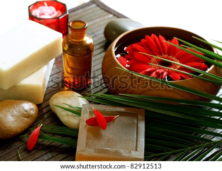 spa composition of soap, stones and flowers - stock photo