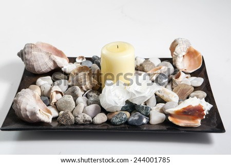 Spa composition with candle and rocks