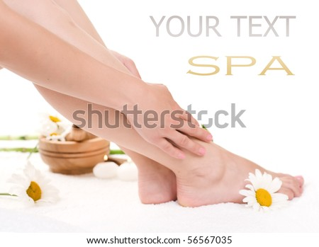 Spa concept.Beautiful Hands and Legs over white