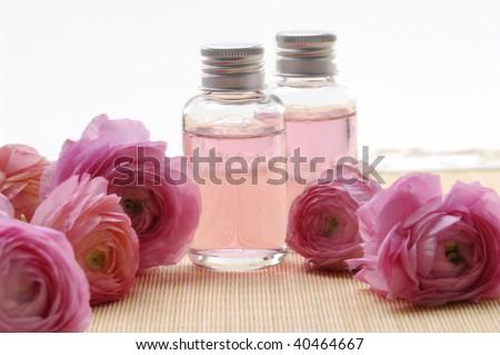 Spa concept- dahlia flower and spa liquid - stock photo