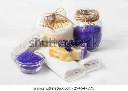 Spa concept. Lavender handmade soap and accessories for body care (lavender, soap, towel, sponge, sea salt) - stock photo