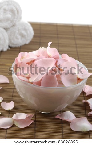 Spa concept of aromatherapy with rose petals - stock photo