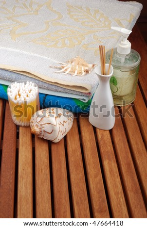 Spa concept of brown color: the towel, soap and candles over sisal background