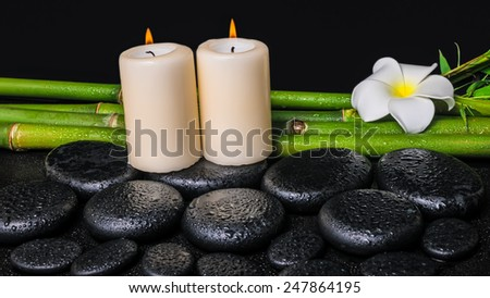 spa concept of zen basalt stones, white flower plumeria, candles and natural bamboo with dew - stock photo