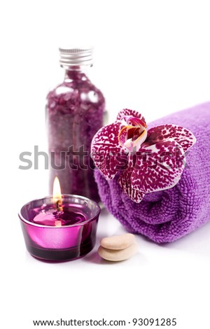 Spa concept ( Orchid, candle, sea salt and towel) over white with sample text