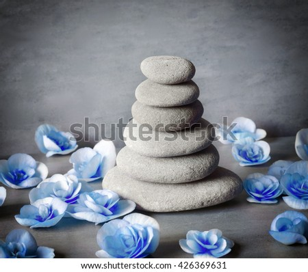 Spa concept. Stones and blue flower. - stock photo