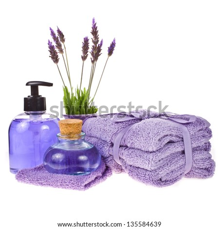 spa concept - towels, gel, lavender water, lavender flowers isolated on white background isolated on white background - stock photo