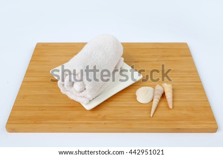 Spa concept, Towels on bamboo board against white background