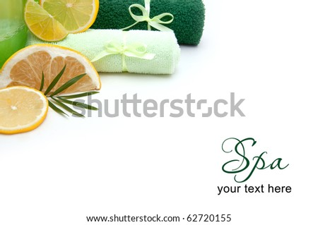 Spa concept, towels, soap and fruits over white with copyspace - stock photo