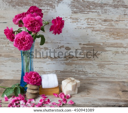 Spa concept with coconut soap,zen stone and beautiful rose flowers on grunge wooden background  - stock photo
