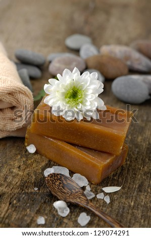 Spa concept with flower and zen stones ,towel on old wooden - stock photo
