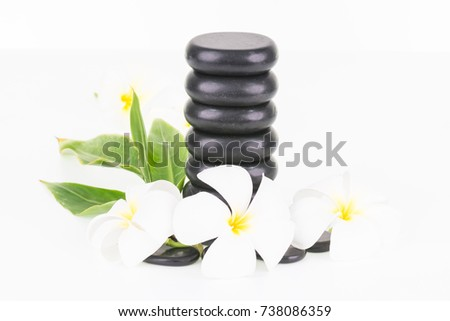 Spa concept with hot stones and Frangipani flowers on white background