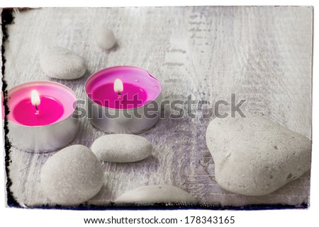 Spa concept with stones and aromatic candles